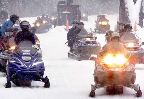 ** FILE ** Snowmobilers pass through the west entrance to Yellowstone National Park, Jan. 3, 2002, in West Yellowstone, Mont. A federal appeals court directed the Environmental Protection Agency on Friday, May 24, 2002, to rework its plan to cut pollution in national parks caused by power plants and other sources, saying part of its 1999 regulation was unlawful. (AP Photo/Bozeman Daily Chronicle, Deirdre Eitel, File)