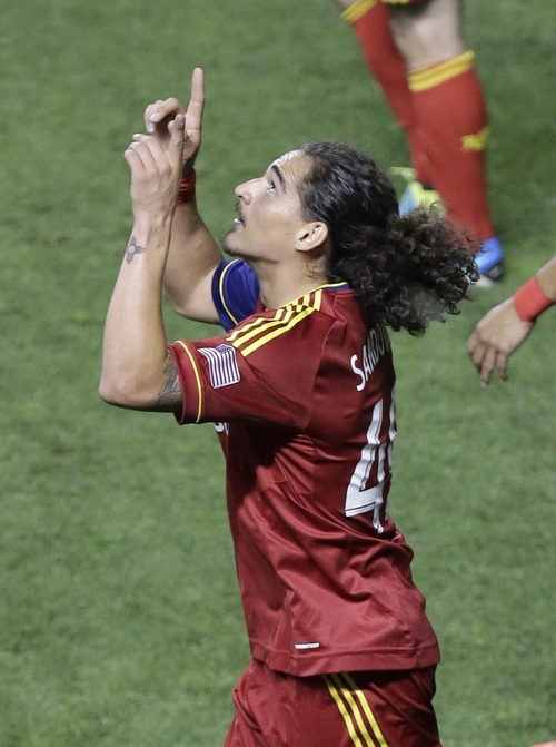 Real Salt Lake's Devon Sandoval points skyward after scoring against the Columbus Crew in the second half during an MLS soccer game Saturday, Aug. 24, 2013, in Sandy, Utah.  (AP Photo/Rick Bowmer)