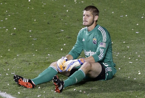 Columbus Crew goalie Matt Lampson sits on the pitch after Real Salt Lake's Luis Gil scored in the second half during an MLS soccer game Saturday, Aug. 24, 2013, in Sandy, Utah. Real Salt Lake won 4-0. (AP Photo/Rick Bowmer)