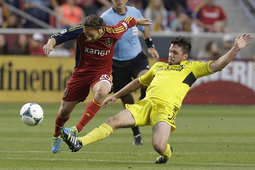 Columbus Crew's Danny O'Rourke, right, defends against Real Salt Lake's Ned Grabavoy during the first half of an MLS soccer game Saturday, Aug. 24, 2013, in Sandy, Utah. (AP Photo/Rick Bowmer)