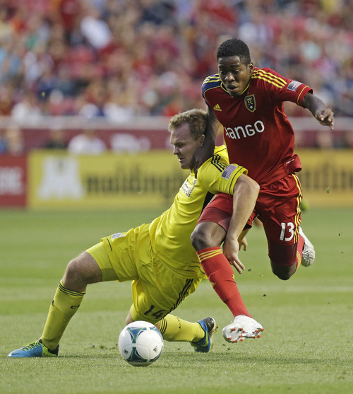 Columbus Crew's Chad Marshall (14) battles with Real Salt Lake's Olmes Garcia (13) in the first half during an MLS soccer game Saturday, Aug. 24, 2013, in Sandy, Utah. (AP Photo/Rick Bowmer)