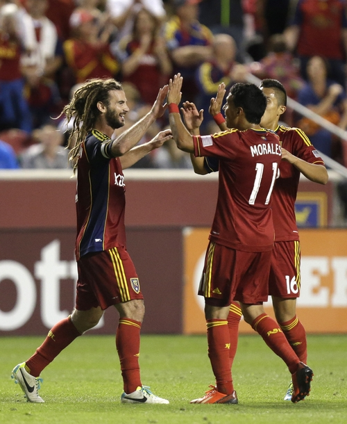 Real Salt Lake's Kyle Beckerman, left, celebrates with teammates Javier Morales (11) and Carlos Salcedo (16) after scoring in the first half during an MLS soccer game against the Columbus Crew on Saturday, Aug. 24, 2013, in Sandy, Utah.  (AP Photo/Rick Bowmer)