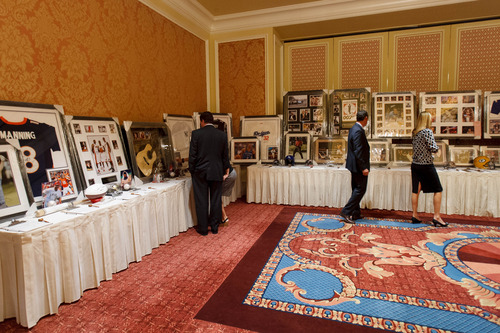 Trent Nelson  |  The Salt Lake Tribune Memorabilia on auction at Utah's Night for Global Citizens with Larry King on Saturday in Salt Lake City.