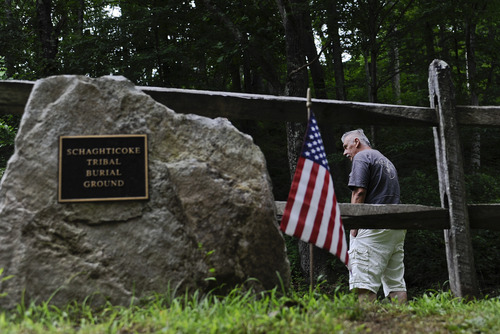 """In this Wednesday, Aug. 7, 2013 photo, Alan Russell, chairman of the Schaghticoke tribe walks in the tribe's burial ground on reservation land in Kent, Conn. A rule change proposed by the Bureau of Indian Affairs could make dozens of American Indian tribes across the country newly eligible for federal recognition by requiring that they demonstrate continuity since only 1934, and not since """"first contact."""" (AP Photo/Jessica Hill)"""