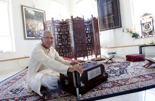 Steve Griffin | The Salt Lake Tribune Temple priest Caru Das plays music inside the Sri Sri Radha Krishna Temple in Spanish Fork on Thursday, Aug. 15, 2013.
