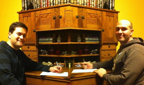 "David Powers King, left, and Michael Jensen sign a deal with Cedar Fort Publishing's Sweetwater Books for their novel ""Woven"" in January. (Courtesy photo)"
