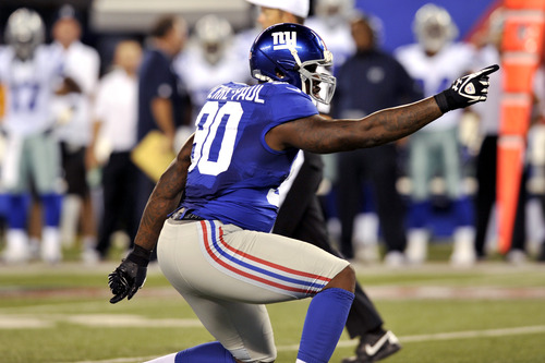 New York Giants defensive end Jason Pierre-Paul reacts during the first half of an NFL football game against the Dallas Cowboys Wednesday, Sept. 5, 2012, in East Rutherford, N.J. (AP Photo/Bill Kostroun)