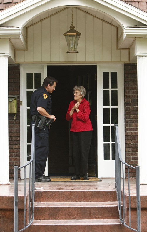 Leah Hogsten  |  The Salt Lake Tribune Salt Lake City police Detective Andy Leonard chats with Marilyn Lundgreen in the Liberty Wells neighborhood about the recent burglaries in the area, Wednesday, May 29, 2013.