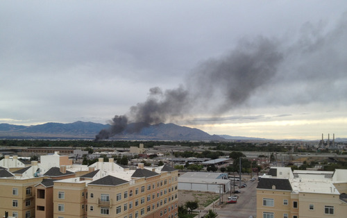 The Salt Lake Tribune A motor home fire was pouring smoke into the air over western Salt Lake City on Monday night.