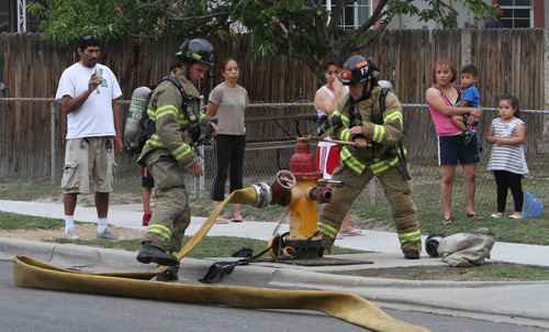 Rick Egan  | The Salt Lake Tribune   Firefighters fight a fire on 1300 West near Arapahoe Avenue,  in Salt Lake City, Monday, August 26, 2013.
