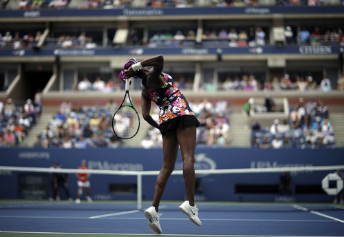 Venus Williams serves to Belgium's Kirsten Flipkens during the first round of the 2013 U.S. Open tennis tournament, Monday, Aug. 26, 2013, in New York. Williams defeated Flipkens. (AP Photo/David Goldman)