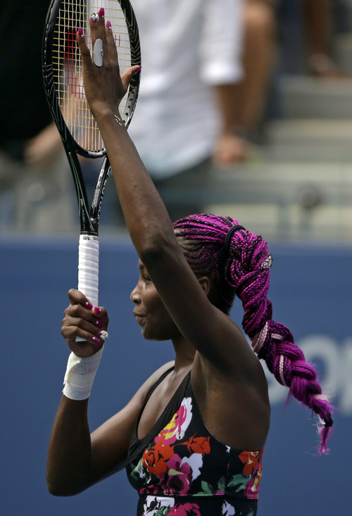 Venus Williams gestures to fans after defeating Kirsten Flipkens, of Belgium, in their first round match at the 2013 U.S. Open tennis tournament, Monday, Aug. 26, 2013, in New York. (AP Photo/David Goldman)