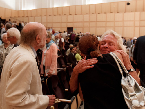 Trent Nelson  |  The Salt Lake Tribune Peggy Battin embraces Katarina Waters at a memorial for her husband Brooke Hopkins, Sunday, August 25, 2013, in Salt Lake City.