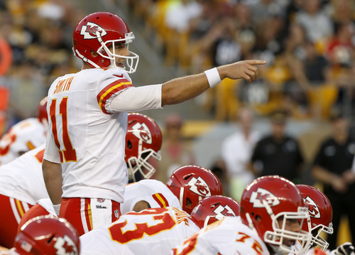 Kansas City Chiefs quarterback Alex Smith calls signals in the first quarter of the NFL preseason football game against the Pittsburgh Steelers Saturday, Aug. 24, 2013 in Pittsburgh. (AP Photo/Keith Srakocic)