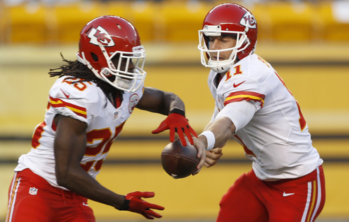 Kansas City Chiefs quarterback Alex Smith (11) hands off to running back Jamaal Charles (25) in the first quarter of the NFL preseason football game against the Pittsburgh Steelers Saturday, Aug. 24, 2013 in Pittsburgh. (AP Photo/Keith Srakocic)