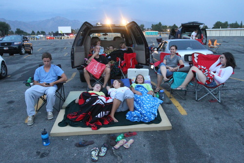 Rick Egan  | The Salt Lake Tribune   The Clark and the Murphy families set up for a double feature at the Redwood Drive-In in West Valley City on Monday, August 19, 2013.