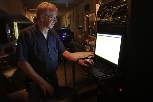 "Rick Egan  | The Salt Lake Tribune   Projectionist of 40 years Earl Shafer works nights manning the new, digital equipment at the Redwood Drive-In on Monday, August 19, 2013. ""I've always been kind of a mechanical guy,"" he said."