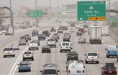 Steve Griffin | The Salt Lake Tribune   Rush hour traffic builds on I-15 near the I-80 interchange in Salt Lake City, Utah Monday June 24, 2013. Salt Lake Chamber and its Utah Transportation Coalition will release a study on the impact of investing in Utah's transportation system.