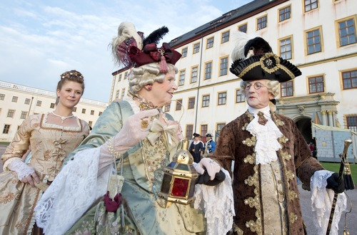 People dressed in Baroque costumes walk in front of the Friedenstein Castle during the opening of the Baroque Festival in Gotha, central Germany, Friday, Aug. 23, 2013. For the last ten years the city of Gotha changes completely into a baroque city in order to celebrate the Baroque Festival around the Friedenstein Castle, the biggest German early Baroque palace complex from the 17th century. (AP Photo/Jens Meyer)