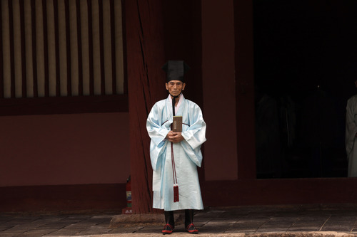 A confucian scholar waits for graduation ceremony at Sungkyunkwan University in Seoul, South Korea, Friday, Aug. 23, 2013. The school was founded in 1398 and considered as the oldest school in East Asia. (AP Photo/Lee Jin-man)
