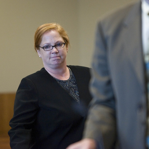 Paul Fraughton  |   The Salt Lake Tribune Former justice court Judge Virginia Ward leaves the courtroom after changing her plea to guilty in the Tooele County courtroom of Judge Robert Adkins.  Tuesday, August 27, 2013