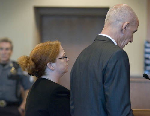 Paul Fraughton  |   The Salt Lake Tribune Former justice court Judge Virginia Ward, standing next to her attorney Earl Xaiz, changes her plea to guilty in the Tooele County courtroom of Judge Robert Adkins.  Tuesday, August 27, 2013