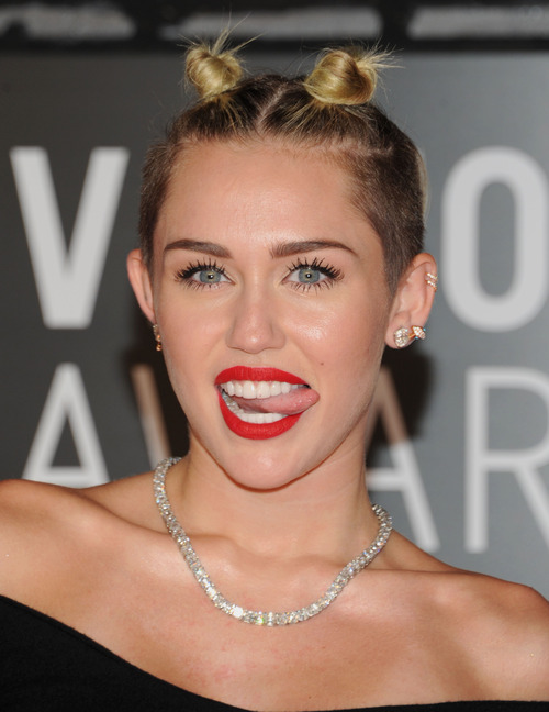 Miley Cyrus arrives at the MTV Video Music Awards on Sunday, Aug. 25, 2013, at the Barclays Center in the Brooklyn borough of New York. (Photo by Evan Agostini/Invision/AP)