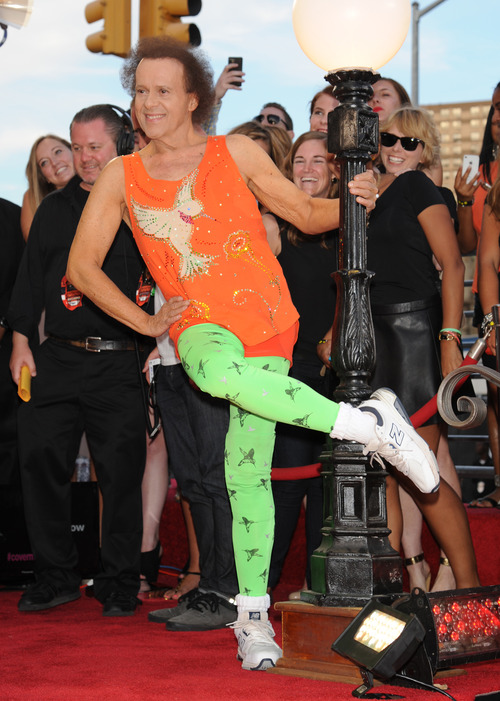 Fitness guru Richard Simmons arrives at the MTV Video Music Awards on Sunday, Aug. 25, 2013, at the Barclays Center in the Brooklyn borough of New York. (Photo by Scott Gries/Invision/AP)