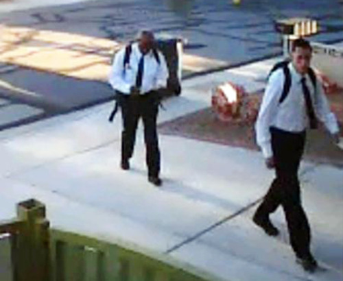 This image provided by the Las Vegas Metropolitan Police Department shows photos from home surveillance video of two suspects who apparently dressed as Mormon missionaries and asked a man to talk about religion before robbing him at gunpoint on the evening of June 27 in the southwest part of the Las Vegas valley. Police say the victim spoke with the men for about five minutes before they jumped him, punched him and stole property at gunpoint. (AP Photo/Las Vegas Metropolitan Police Department)