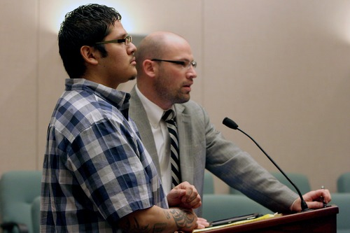 Jesse Anthony Saenz, foreground, stands with his attorney, Clint Hendricks, during a status hearing Tuesday, March 26, 2013, in 8th District Court. Saenz, 23, is accused of attacking a Uintah County woman and sexually assaulting her in June 2012. Saenz was sentenced Aug. 28, to a mandatory 25 years to life in prison for the rape. (AP PHOTO/Geoff Liesik, Deseret News)