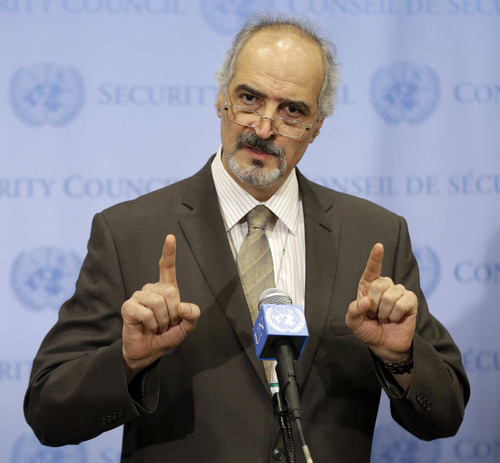 Syrian Ambassador to the United Nations Bashar Ja'afari speaks to reporters after a meeting about Syria at United Nations headquarters Wednesday, Aug. 28, 2013. The five permanent members of the U.N. Security Council met informally to discuss the language of a draft resolution that would authorize the use of military force against Syria. (AP Photo/Seth Wenig)