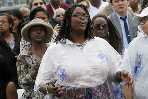 Audience members sing during the benediction for the 50th Anniversary of the March on Washington where Martin Luther King, Jr., spoke, Wednesday, Aug. 28, 2013, in front of the Lincoln Memorial in Washington. (AP Photo/Charles Dharapak)