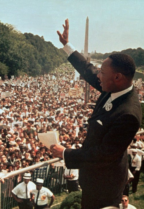 FILE - The Rev. Martin Luther King Jr. waves to the crowd at the Lincoln Memorial on Aug. 28, 1963.  (AP Photo/File)