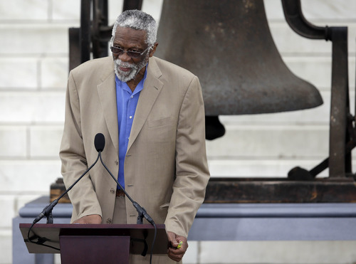 """Former Boston Celtics basketball player Bill Russell speaks at the Let Freedom Ring ceremony at the Lincoln Memorial in Washington,Wednesday, Aug. 28, 2013, to commemorate the 50th anniversary of the 1963 March on Washington for Jobs and Freedom. It was 50 years ago today when Martin Luther King Jr. delivered his """"I Have a Dream"""" speech from the steps of the memorial. (AP Photo/Carolyn Kaster)"""