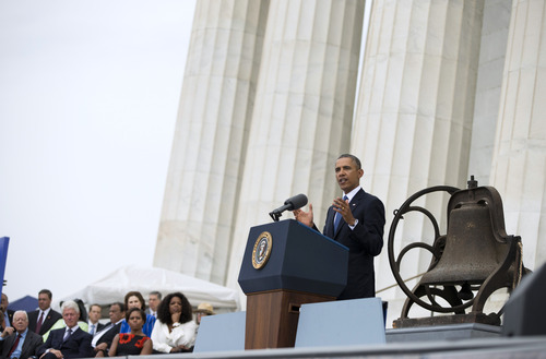 """President Barack Obama gestures while speaking during a ceremony commemorating the 50th anniversary of the March on Washington, Wednesday, Aug. 28, 2013, at the Lincoln Memorial in Washington. The president was set to lead civil rights pioneers Wednesday in a ceremony for the 50th anniversary of the March on Washington, where Dr. Martin Luther King's """"I Have a Dream"""" speech roused the 250,000 people who rallied there decades ago for racial equality. (AP Photo/Evan Vucci)"""