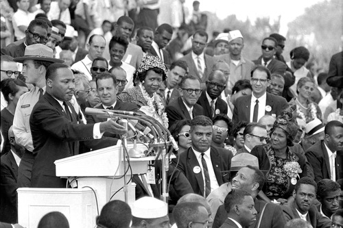 """FILE - The Rev. Dr. Martin Luther King Jr., head of the Southern Christian Leadership Conference, speaks to thousands during his """"I Have a Dream"""" speech in front of the Lincoln Memorial for the March on Washington for Jobs and Freedom in Washington on Aug. 28, 1963. Actor-singer Sammy Davis Jr. is at bottom right. (AP Photo/File)"""