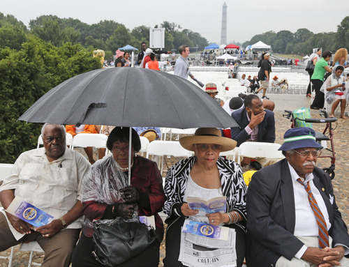 From left to right: Stanley Samuels and Rita Samuels, from Atlanta, Ga.; Sammie Whiting-Ellis, from Washington, D.C.; and Henry H. Brown, from Houston, Texas; who attended the March on Washington 50 years ago where Martin Luther King, Jr., spoke, wait for the anniversary program to begin in front of the Lincoln Memorial in Washington, Wednesday, Aug. 28, 2013. (AP Photo/Charles Dharapak)