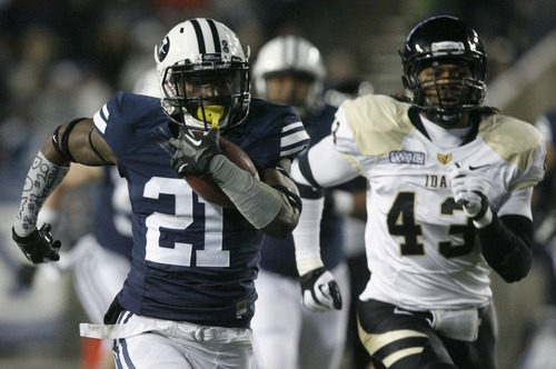 Rick Egan  | The Salt Lake Tribune   Brigham Young Cougars running back Jamaal Williams (21) is chased by Idaho Vandals defensive end Quinton Bradley (43), as he runs for a huge gain, in football action, BYU vs. Idaho Vandals, at Lavell Edwards Stadium, Saturday, November 10, 2012