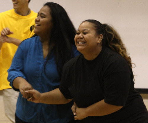 Rick Egan  | The Salt Lake Tribune  Sisters Mele Fainu (left) and Ana Fainu (right) participate in Native American aerobics at the Calvary Baptist Church in southern Salt Lake City during a health fair on Saturday, August 24. With Glendale, South Salt Lake has the highest rates of uninsured residents in the state.