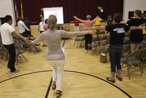 Rick Egan  | The Salt Lake Tribune  Gay Dawn Pinnecouse leads a group in Native American Aerobics at the Calvary Baptist Church in southern Salt Lake City during a health fair on Saturday, Aug. 24. With Glendale, South Salt Lake has the highest rates of uninsured residents in the state.