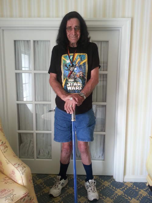"""Peter Mayhew, Chewbacca in """"Star Wars"""" movies, stands with his lightsaber cane. (Courtesy of Peter Mayhew)"""