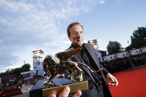 Director William Friedkin holds his Golden Lion for Lifetime Achievement award during the 70th edition of the Venice Film Festival in Venice, Thursday, Aug. 29, 2013. (AP Photo/Andrew Medichini)