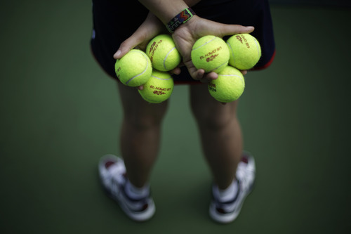 A ball runner  waits during the second round of the 2013 U.S. Open tennis tournament, Thursday, Aug. 29, 2013, in New York. (AP Photo/David Goldman)