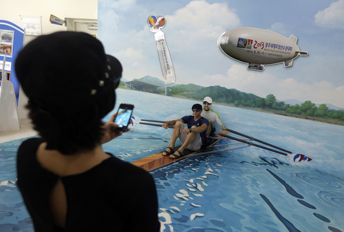 Visitors take their souvenir photos during the World Rowing Championships in Chungju, south of Seoul, South Korea, Thursday, Aug. 29, 2013. (AP Photo/Lee Jin-man)