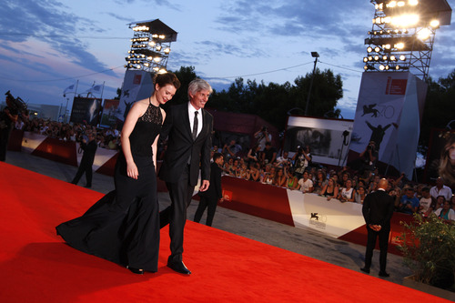 Actress Mia Wasikowska and director John Curran arrive on the red carpet for the screening of their film Tracks, at the 70th edition of the Venice Film Festival held from Aug. 28 through Sept. 7, in Venice, Italy, Thursday, Aug. 29, 2013. (AP Photo/Andrew Medichini)