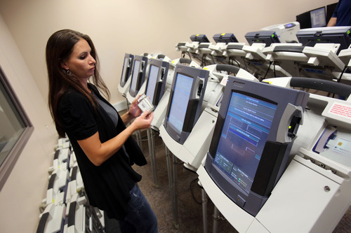 Francisco Kjolseth  |  The Salt Lake Tribune Jenn Brereton, lead elections coordinator, uploads memory cards used to record votes in different jurisdictions on Thursday at 9 a.m., as the Salt Lake County Clerk's elections staff conducts a recount of two tight primary mayoral races. In South Salt Lake, former City Councilman Shane Siwik was only two votes behind political newcomer Derk Pehrson. In West Valley City, Don Christensen came in only 13 votes behind Karen Lang.