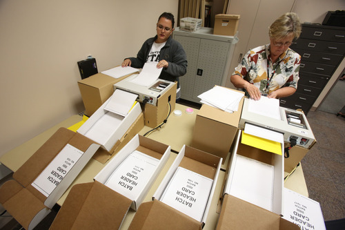 Francisco Kjolseth  |  The Salt Lake Tribune Election coordinators Antigone Carlson, left, and Barbara Beckstrom use optical scanners to count absentee or vote-by-mail ballots on Thursday morning as the Salt Lake County Clerk's elections staff conducts a recount of two tight primary mayoral races. In South Salt Lake, former City Councilman Shane Siwik was only two votes behind political newcomer Derk Pehrson. In West Valley City, Don Christensen came in only 13 votes behind Karen Lang.