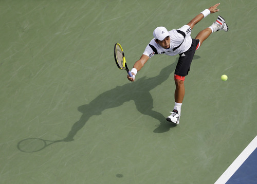 Lu Yen-Hsun of Taiwan lunges for a shot against Tommy Haas of Germany in the second round of the 2013 U.S. Open tennis tournament, Friday, Aug. 30, 2013, in New York. (AP Photo/Julio Cortez)