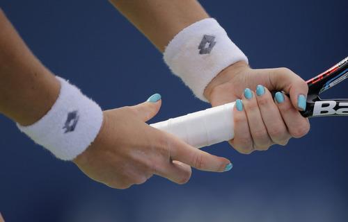 Agnieszka Radwanska of Poland prepares for a serve from Anastasia Pavlyuchenkova of Russia during the third round of the 2013 U.S. Open tennis tournament, Friday, Aug. 30, 2013, in New York. (AP Photo/Mike Groll)