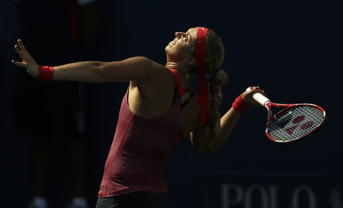 Sabine Lisicki of Germany serves to Ekaterina Makarova of Russia during the third round of the 2013 U.S. Open tennis tournament, Friday, Aug. 30, 2013, in New York. (AP Photo/Julio Cortez)